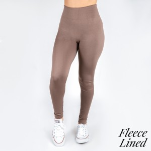 New Kathy / New Mix mocha, fleece lined leggings are seamless, chic, and a must-have for every wardrobe. These cozy, full-length leggings are versatile, perfect for layering, and available in many shades. Smooth fabric, 92% Nylon 8% Spandex. One size fits most, fits US women's 0-14.