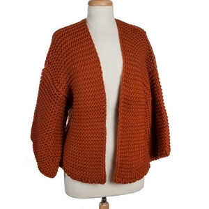 Rust orange, knit cardigan with 3/4 length sleeves. 100% acrylic. One size fits most.