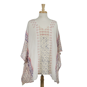 White poncho top with a red and blue pattern and crocheted sides. 100% cotton. One size fits most.