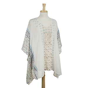 White poncho top with a turquoise and brown pattern and crocheted sides. 100% cotton. One size fits most.