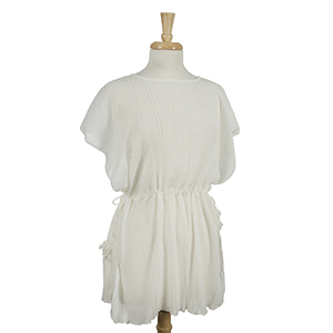 White, accordion pleated poncho top with tie sides. 100% polyester. One size fits most.