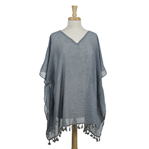 Lightweight, blue, poncho with tassels. 100% viscose. One size fits most.