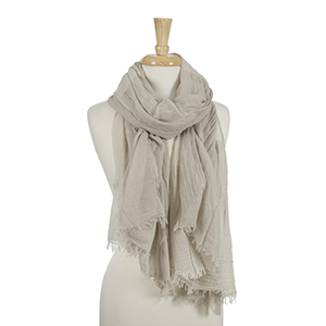 "Beige and light gray open scarf with frayed edges. 45% viscose and 55% cotton. Measures approximately 38"" x 80."""