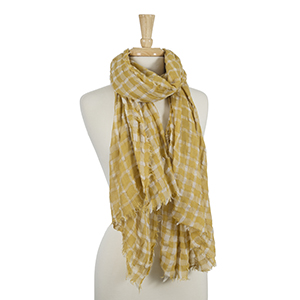 "Lightweight mustard yellow and white gingham printed scarf with frayed edges. 100% viscose. Measures approximately 33"" x 76."""