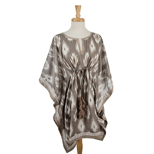 Lightweight taupe and gray poncho with an ikat pattern and a cinch waist. 100% cotton. One size fits most and can be worn as a swimsuit cover up.