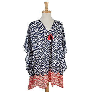 Lightweight navy blue and white printed poncho with tassel accents. 100% cotton. One size fits most and can also be worn as a swimsuit cover up.