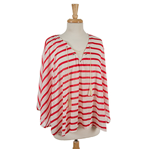 Red and white striped poncho with a lace up front neckline. 35% cotton and 65% polyester. One size fits most.