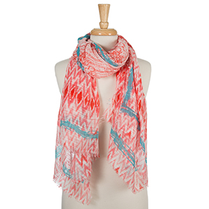 "Coral and white open scarf with a tie-dye print and turquoise accents. 100% cotton. Measures approximately 36"" x 72."""