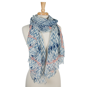 "Navy blue and white open scarf with a tie-dye print and pale pink accents. 100% cotton. Measures approximately 36"" x 72."""