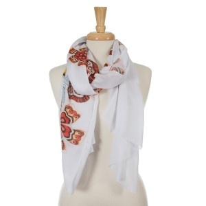 """White open scarf with yellow and red flowers. 100% polyester. Approximately 36"""" x 72"""" in size."""