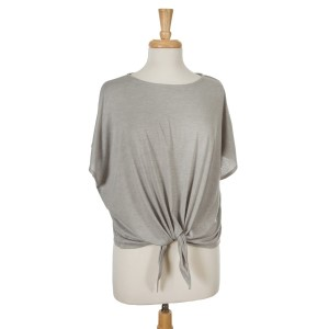 Gray short sleeve top with a tie front. 65% viscose and 35% polyester. One size fits most.