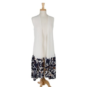 White sleeveless, duster length vest with a navy blue floral pattern on the bottom. 100% polyester. one size fits most.