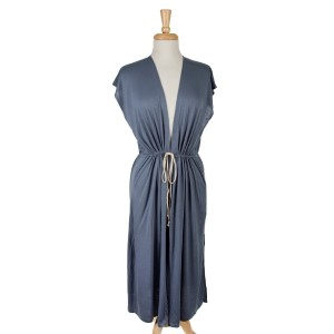 Navy blue sleeveless, duster length vest with side slits and a tie front. 65% viscose and 35% polyester. One size fits most.