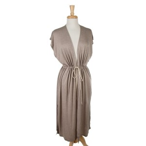 Taupe sleeveless, duster length vest with side slits and a tie front. 65% viscose and 35% polyester. One size fits most.