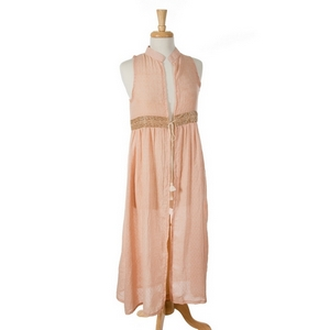 Peach sleeveless, duster length vest featuring a glitter waist line and a tie front. 100% cotton. One size.