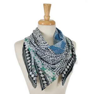 "Ivory square scarf featuring a navy blue and teal print and frayed edges. 100% cotton. Measures approximately 42"" x 42"" in size."