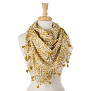 "Mustard yellow and white tie-dye print square scarf with pom poms along the edges. 100% cotton. Measures approximately 42"" x 42"" in size."
