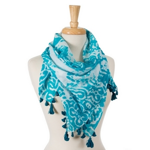 "Turquoise and white tie-dye damask print square scarf with pom poms along the edges. 100% cotton. Measures approximately 42"" x 42"" in size."