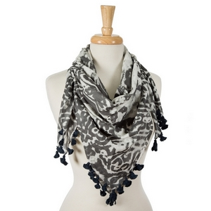 "Charcoal and white tie-dye damask print square scarf with pom poms along the edges. 100% cotton. Measures approximately 42"" x 42"" in size."