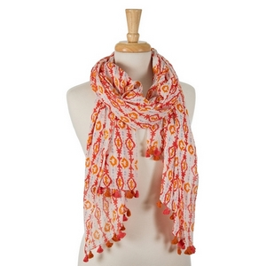 "Coral, orange, and light blue printed, open scarf with pom poms on the ends. 100% cotton. Measures approximately 28"" x 72"" in size."