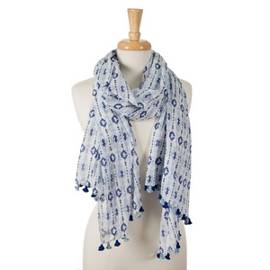 "Navy blue, light blue and white printed, open scarf with pom poms on the ends. 100% cotton. Measures approximately 28"" x 72"" in size."