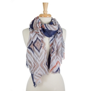 "White lightweight open scarf featuring a coral, navy blue and taupe pattern and a navy edge. 100% viscose. Approximately 35"" x 70"" in size."