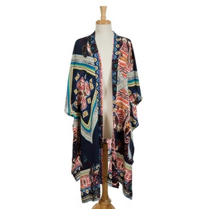 Navy blue short sleeve kimono featuring multicolored tribal and paisley prints. 100% viscose. One size fits most.
