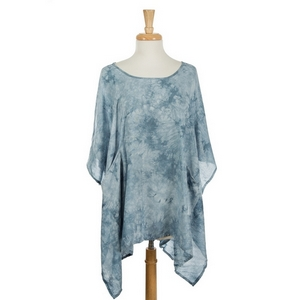 Blue mineral washed, short sleeve poncho featuring two front pockets. 100% viscose. One size fits most.