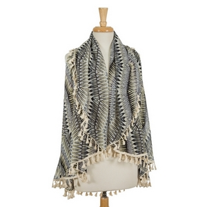 Black, gray, and yellow printed vest featuring ivory tassels along the outer edges. 90% polyester and 10% cotton. One size fits most.