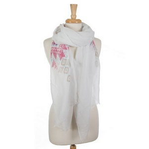 "Lightweight white scarf featuring a pink tribal print and frayed edges. 35% viscose and 65% polyester. Measures approximately 78"" x 36"" in size."