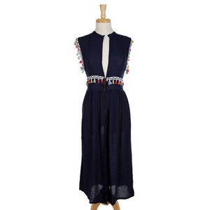 Navy blue, duster length vest featuring a tie at the wait and bright tassel accents. 100% rayon. One size, fits up to a large.