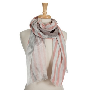 "Coral, gray and white open scarf with a striped pattern. 70% polyester and 30% cotton. Measures approximately 36"" x 68"" in size."