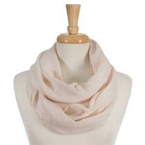 "Beige infinity scarf featuring coral and ivory embroidered circles. 70% polyester and 30% cotton. Measures approximately 18"" x 32"" in size."
