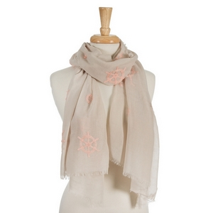 "Beige open scarf featuring peach embroidered anchors and ship's wheels. 70% polyester and 30% cotton. Measures approximately 32"" x 68"" in size."