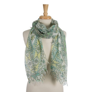"White open scarf featuring a mint green and yellow floral and paisley pattern. 70% polyester and 30% cotton. Measures approximately 34"" x 72"" in size."