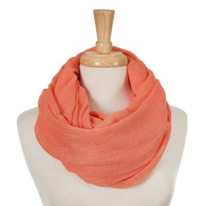 """Peach, lightweight infinity scarf. 100% cotton. Approximately 35"""" x 42"""" in size."""