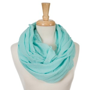 """Aqua, lightweight infinity scarf. 100% cotton. Approximately 35"""" x 42"""" in size."""