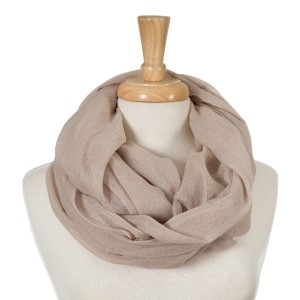 """Beige, lightweight infinity scarf. 100% cotton. Approximately 35"""" x 42"""" in size."""