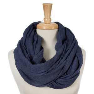 """Navy blue, lightweight infinity scarf. 100% cotton. Approximately 35"""" x 42"""" in size."""