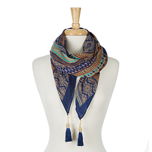 """Orange and navy blue printed square scarf with tassels on each corner. 100% polyester. Measures 50"""" x 50"""" in size."""