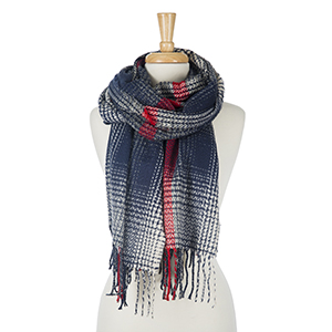 """Navy blue, red and white printed, open scarf with tassels on the ends. 100% acrylic. Measures 28"""" x 80"""" in size."""