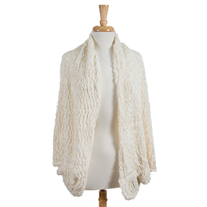 Ivory cocoon kimono with a faux fur texture. 100% polyester. One size fits most.