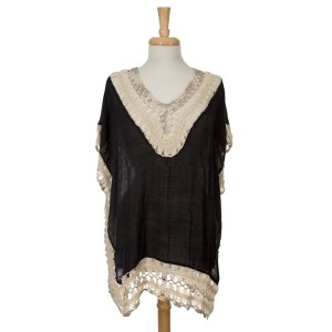 Black short sleeve top with crochet detailing. Top is sewn all the way down to the bottom hem. 35% acrylic and 65% viscose. One size fits most.