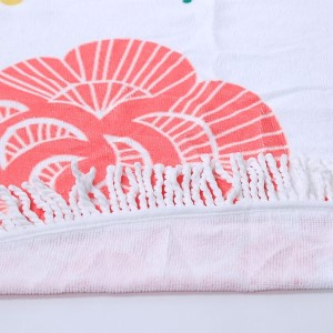 """""""Love"""" and flower printed terry cloth roundie beach towel with frayed edges. 100% cotton. Approximately 60"""" in diameter."""