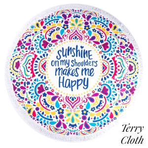"""""""Sunshine on my shoulders makes me happy"""" printed terry cloth roundie beach towel with frayed edges. 100% cotton. Approximately 60"""" in diameter."""