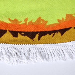 "Kiwi printed terry cloth roundie beach towel with frayed edges. 100% cotton. Approximately 60"" in diameter."