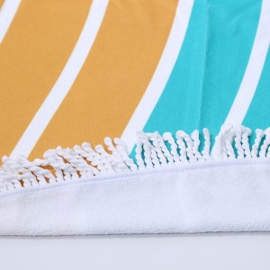"""Turquoise and yellow pineapple printed terry cloth roundie beach towel with frayed edges. 100% cotton. Approximately 60"""" in diameter."""