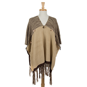 Brown and tan poncho top with tassels. 100% acrylic. One size fits most.