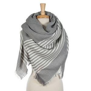 """Gray and white striped blanket scarf. 100% acrylic. Measures 56"""" x 56"""" in size."""