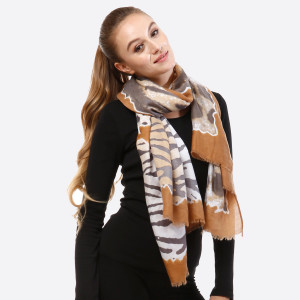 """Mustard yellow and gray open scarf with animal prints and frayed edges. 100% viscose. Measures 36"""" x 72"""" in size."""